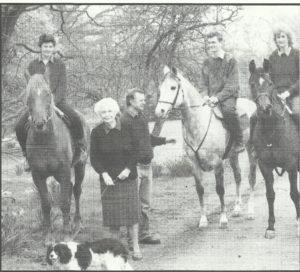 Monica Calvert and dog, with George and John Moore and family